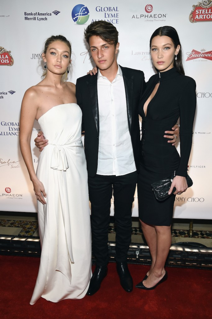 """NEW YORK, NY - OCTOBER 08: (L-R) Gigi Hadid, Anwar Hadid and Bella Hadid attend the Global Lyme Alliance """"Uniting for a Lyme-Free World"""" Inaugural Gala at Cipriani 42nd Street on October 8, 2015 in New York City. (Photo by Dimitrios Kambouris/Getty Images for Global Lyme Alliance)"""