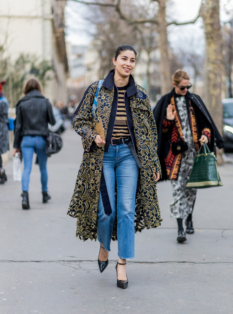 PARIS, FRANCE - MARCH 08: Caroline Issa wearing a coat with a golden print and denim jeans outside Ellery during the Paris Fashion Week Womenswear Fall/Winter 2016/2017 on March 8, 2016 in Paris, France. (Photo by Christian Vierig/Getty Images)
