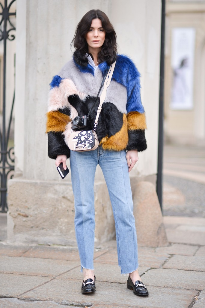 MILAN, ITALY - FEBRUARY 26: A guest poses wearing an Hofmann Copenhagen fur, Vetements pants and Tod's bag and shoes before the Tod's show during the Milan Fashion Week Fall/Winter 2016/17 on February 26, 2016 in Milan, Italy. (Photo by Vanni Bassetti/Getty Images)