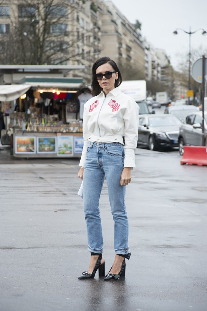 PARIS, FRANCE - JANUARY 27: Fashion blogger Evangelie Smyrniotaki wears an Olympia Le Tan jacket, Vetements jeans, NGR sunglasses and Dior shoes on day 4 of Paris Haute Couture Fashion Week Spring/Summer 2016, on January 27, 2015 in Paris, France. (Photo by Kirstin Sinclair/Getty Images)